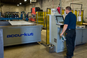 A Matot employee tests that quality of metal during the dumbwaiter manufacturing process.