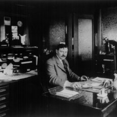 Matot's original founder shown in his office, in black and white.